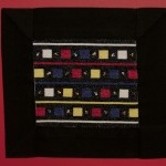 """Perle nel vuoto"", 2012 Punto croce. Cotone su cotone con perline Dimensioni ricamo:  17 cm x 20 cm""Pearls in the empty space"", 2012Cross stitchSize of the embroidery (made of cotton with seed beads): 17 cm x 20 cm"